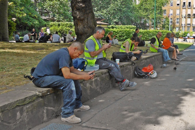 Texting in the park - some rights reserved - duncanh1