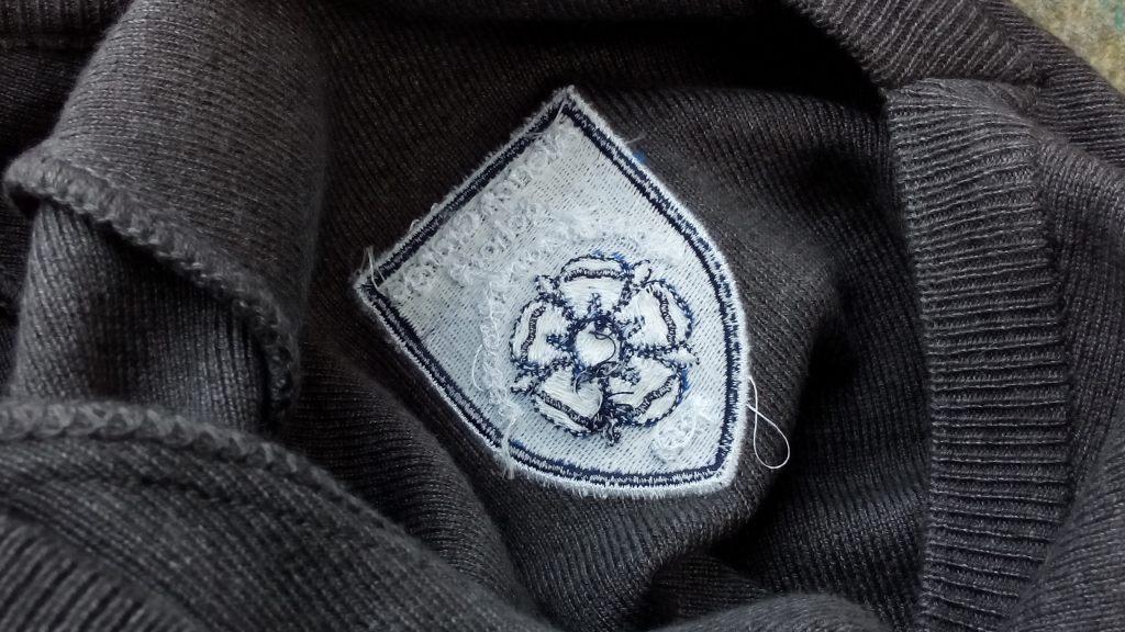school logo on inside of jumper