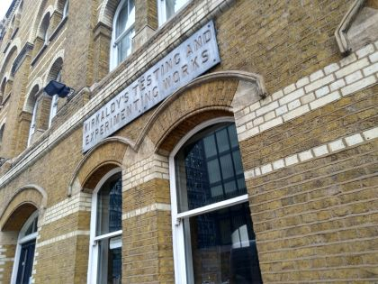 "Victorian London brick building with sign that says ""Kirkaldy's Testing and Experimenting Works"""
