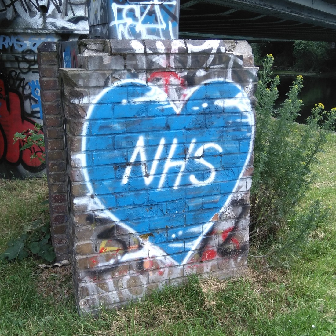 graffiti: NHS letters in a blue heart