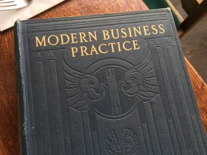"Old tattered book cover titled ""MODERN BUSINESS PRACTICE"""