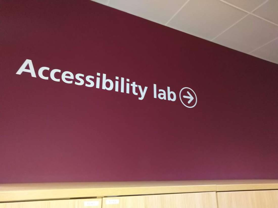 "Lettering on wall: ""Accessibility lab"" with arrow pointing to right"