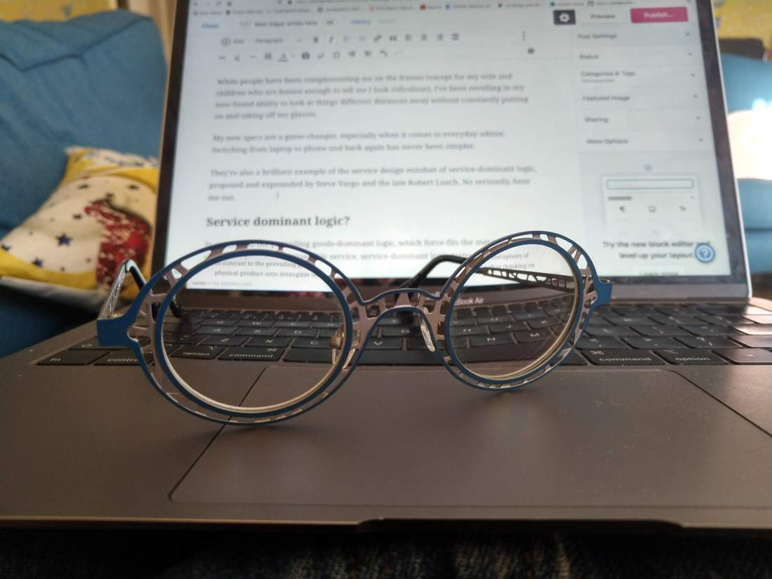 Glasses resting on laptop keyboard