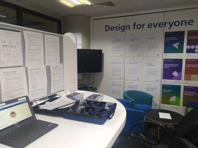 Accessibility lab with Chromebook and large letters on wall that read: Design for everyone